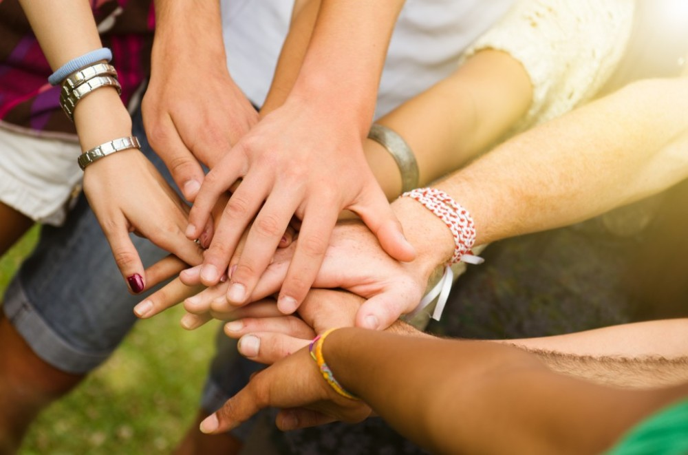 genwire_stacked_hands_together-1024x677